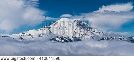 Crystal Mountain Peak Emerges From The Cloud Cover To Reveal Its Magestic Power And Detail. Extreme