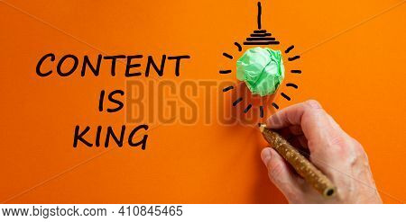 Content Is King Symbol. Businessman Writing Words 'content Is King', Isolated On Beautiful Orange Ba