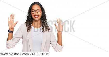 Young african american girl wearing business clothes showing and pointing up with fingers number ten while smiling confident and happy.