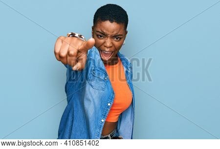Young african american woman wearing casual clothes pointing displeased and frustrated to the camera, angry and furious with you