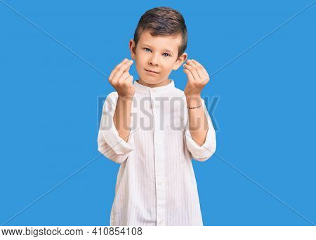 Cute blond kid wearing elegant shirt doing money gesture with hands, asking for salary payment, millionaire business