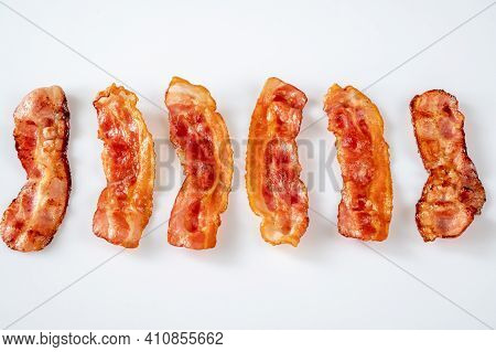 Fried Bacon Strips On The White Background