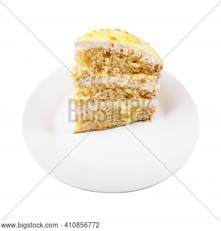 A Piece Of Biscuit Creamy Cake Glazed With Yellow Glaze And Decorated With Shavings Of Orange Peel O