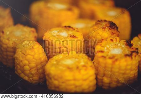 Grilled Corn On The Cob With Oil And Salt On The Grill Rack, Close-up