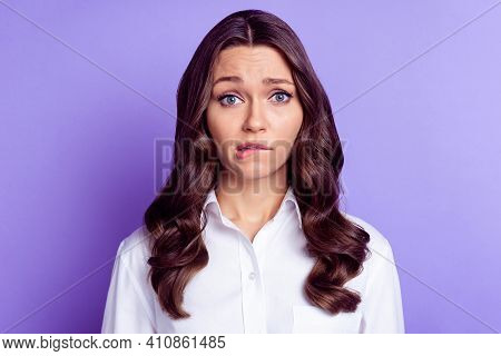 Photo Of Nervous Business Lady Look Camera Bite Lip Wear White Shirt Isolated Purple Color Backgroun