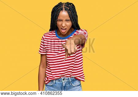 Beautiful hispanic woman wearing casual clothes pointing displeased and frustrated to the camera, angry and furious with you