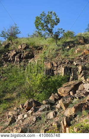 A Rocky Slope Of An Abandoned Granite Quarry In The Nikolaev Region Of Ukraine On A Hot Summer Day.