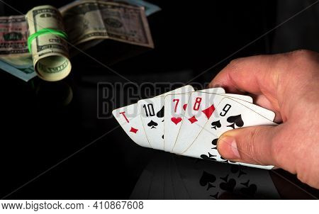 Poker Cards With A High Card Combination. Closeup Of A Gambler Hand Is Holding Playing Cards In Casi