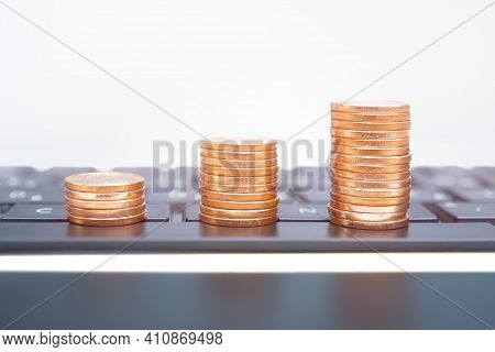 Make Money Online Investment Growth Income Streams. Growing Stacks Coins On Computer Keyboard. Depos