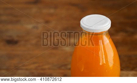 Juice Bottle On Wood Background - Fresh Orange Juice. It Can Be Orange, Buckthorn, Carrot, Mango Or