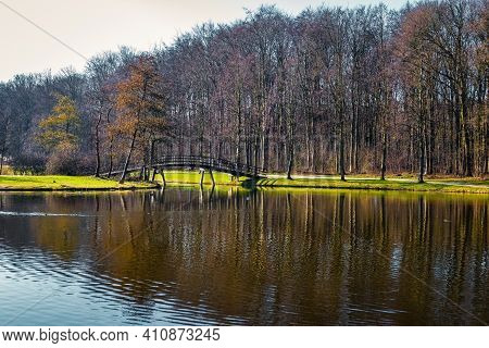 Forest Called Haagse Bos In The Hague Netherlands On Sunny Day With Blue Sky And Reflection In The W