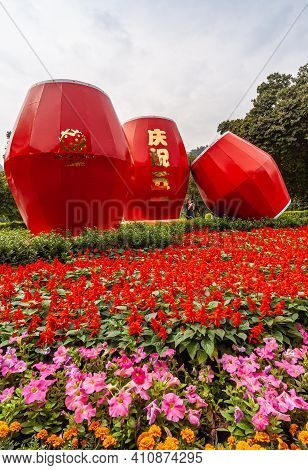 Guilin, China - May 11, 2010: Seven Star Park. Portrait Of Giant Red Drums Statue Set In Red And Pin