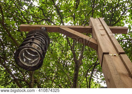 Guilin, China - May 11, 2010: Seven Star Park. Fisheye View On Metal Lantern Hanging From Wooden Bea