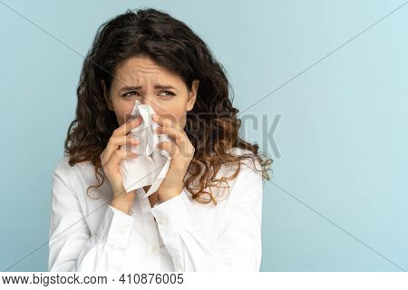 Studio Portrait Of Young Office Employee Woman In White Blouse With Tissue Blowing Nose, Isolated On