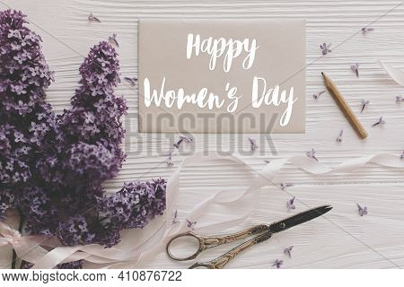 Happy Womens Day Greeting Card. Stylish Handwritten Text Sign On Paper Card And Lilac Flowers, Vinta