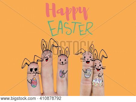 Happy easter text with fingers decorated with bunny ears and easter eggs on orange background. easter holiday celebration concept digitally generated image.