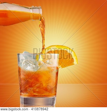 Glass Of Iced Cold Aperol Spritz Cocktail Decorated With Slices Of Orange. Aperitif, Making Coctail,