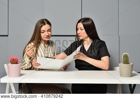Beautician And Client Signing Consent For Depilation Procedure