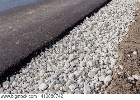 New Motor Road. Paved Bituminous Asphalt Based On Gravel. Road Layers. Road Composition