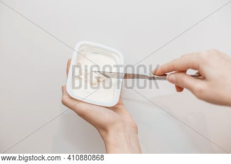 Butter On A Slice Of Knife. Steel Knife Over A Briquette Piece Of A Butter. Isolated Over The White