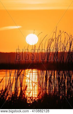 Sundown Above Lake River Horizon At Sunset. Natural Sky In Warm Colors Water. Sun Waters.