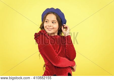 Happy Parisian Child In French Beret Hat And Elegant Red Dress On Yellow Background, Kid Retro Fashi