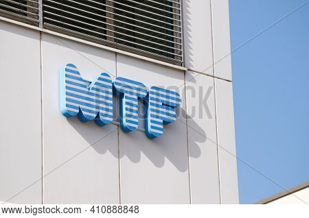 Zug, Switzerland - 26th February 2021 : Mtf Company Sign Hanging On A Building In Zug, Switzerland.