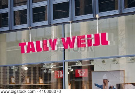Zug, Switzerland - 26th February 2021 : Tally Weijl Sign Hanging In Front Of The Store Building In Z