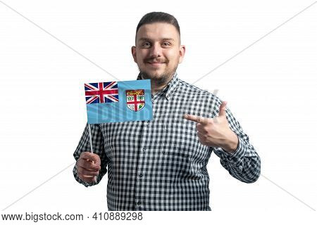 White Guy Holding A Flag Of Fiji And Points The Finger Of The Other Hand At The Flag Isolated On A W
