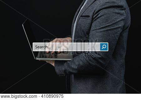 Internet Search Concept With A System And A Magnifying Glass On The Background Of A Businessman With