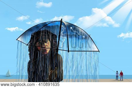 A Girl On A Sunny Ocean Beach Is Seen Under Her Umbrella That Contains A Small Dark And Rainy Atmosp
