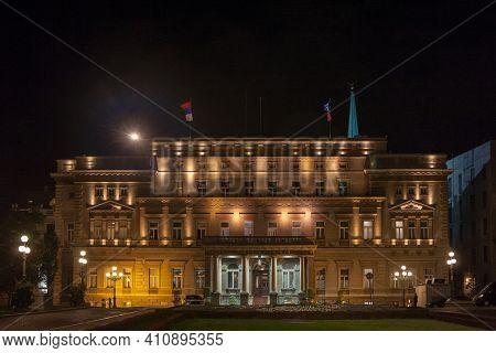 Main Facade Of Stari Dvor, The City Hall Of Belgrade, Also Called Skupstina, At Night. It Is The Sea