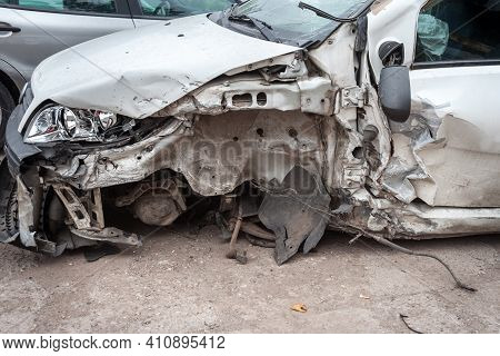 Dented Bodywork Of A Damaged Car Wing, With Steel Crushed After A Traffic Accident That Completely D