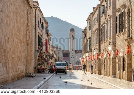 Dubrovnik, Croatia - Aug 22, 2020: Empty Stradun Street In Old Town With View Of Bell Tower Cupola I