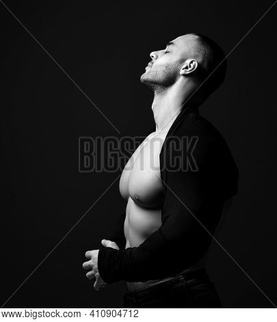 Portrait Of Muscular Man, Athlete With Perfect Body Wearing Shirt With Longsleeves Standing Sideways