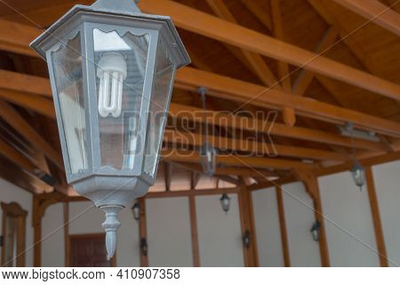 Vintage Metal Hexagon Lantern With Dusty Glass And Energy-saving Spiral Lamp Inside Suspended Inside