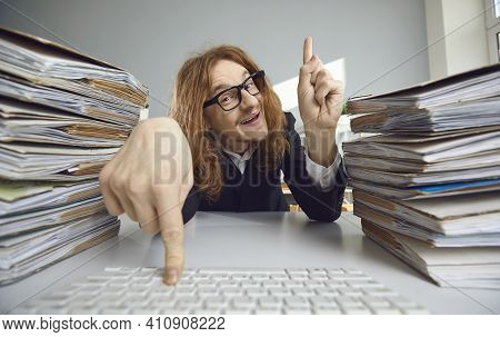 Funny Guy Organizing Digital Archive On Computer Instead Of Dealing With Piles Of Papers