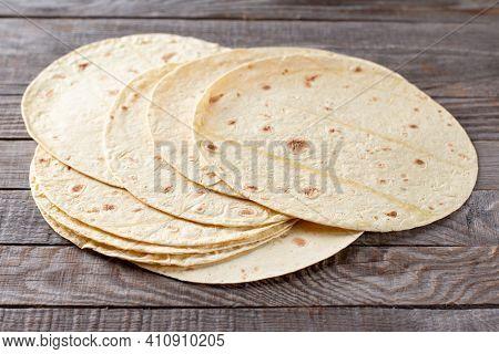 Mexican Corn Tortillas For Sentencing Tacos, Quesadilla, Fajitos, Tortilla On A Wooden Table