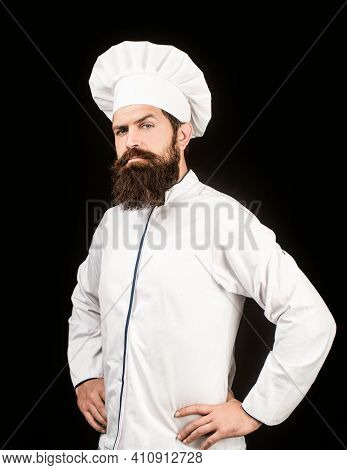 Portrait Of A Serious Chef Cook. Bearded Chef, Cooks Or Baker. Bearded Male Chefs Isolated On Black.