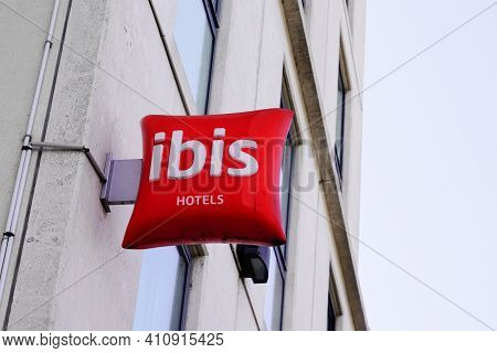 Bordeaux , Aquitaine France - 03 03 2021 : Ibis Hotel Sign Red Text And Brand Cushion Logo Building