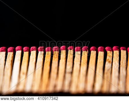 Wooden Matches With Red Sulfur Heads On A Black Background. Fire Ignition Matches. Matchbox. Red Sul
