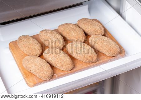 Frozen Food In The Refrigerator. Plastic Bag With Cutlets In Refrigerator, Closeup