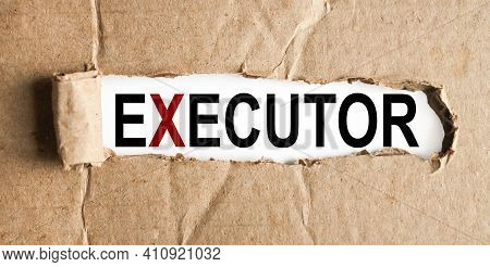 Executor. Business Concept. Text On White Paper Over Torn Paper Background.