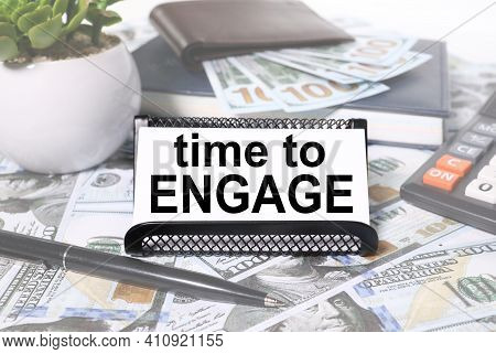 Time To Engage. Text On White Paper On The Background Of Calculator And Money Bills