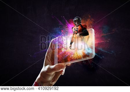 Football player on mobile phone screen