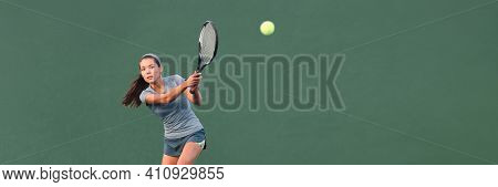 Tennis player playing game on outdoor hard court banner. Athlete Asian woman hitting ball with racket during match panoramic header. on green banner. Sports in competition.