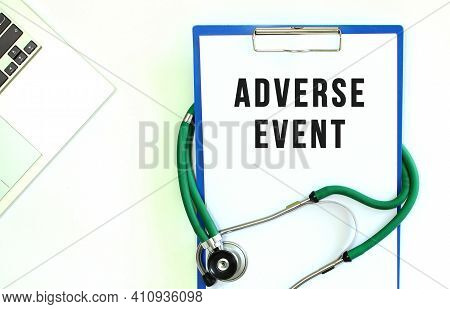 Stethoscope And Clipboard With Adverse Event Text On White Sheet Of Paper And Copy Space.