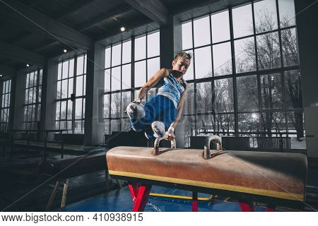 Champion. Little Male Gymnast Training In Gym, Composed And Active. Caucasian Fit Boy, Athlete In Sp