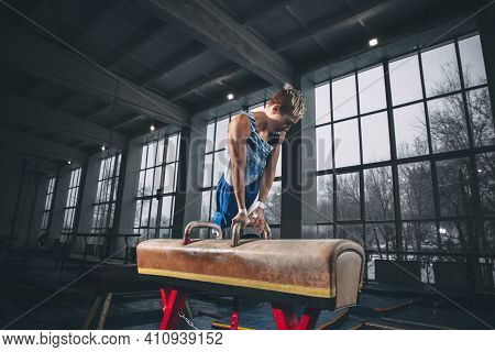 Lead. Little Male Gymnast Training In Gym, Composed And Active. Caucasian Fit Boy, Athlete In Sports