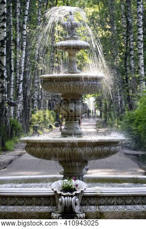 Old City Multi-tiered Fountain. A Dilapidated Fountain In The Countryside. Water Flows From The Foun